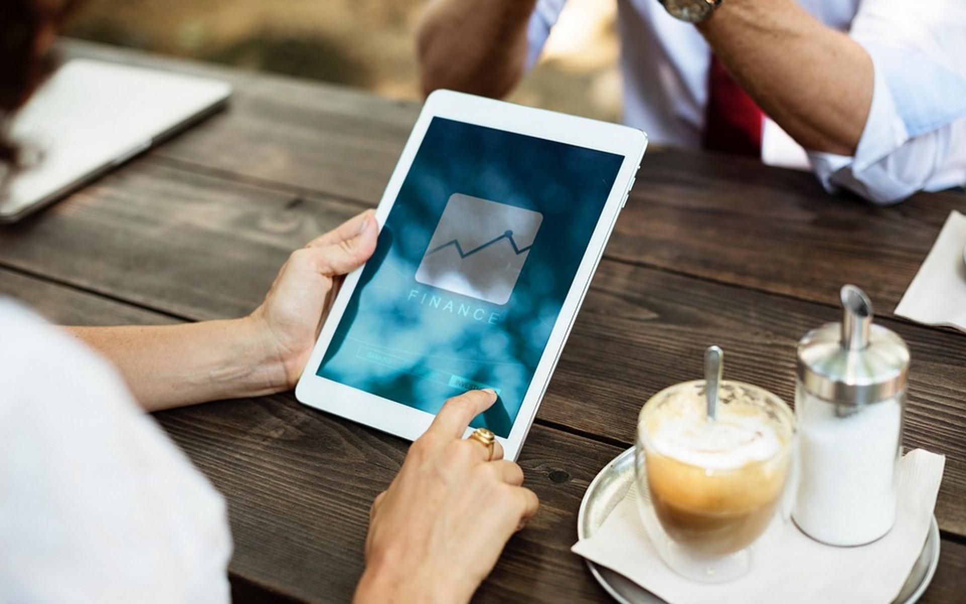 Mortgage broker, iPad finance graph